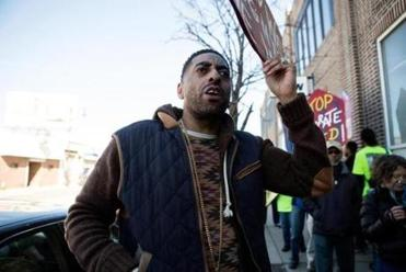 Housing advocate Antonio Ennis participated in a demonstration Saturday.