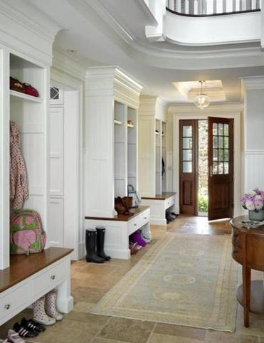 Columns and rounded room entrances present this home as both formal and playful.