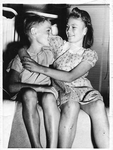 "Eight-year-old ""Sonny"" Downs and his 11-year-old sister, Lucille, in 1942."