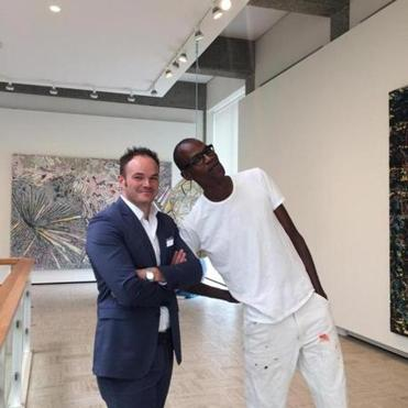 Christopher Bedford (left), director of the Rose Art Museum at Brandeis University, with artist Mark Bradford at the Rose in 2014.