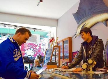 01muther Toronto DSC_0438, 0437, 0435, 0431, 0430 -- Jenna Allain of the store Model Citizen in Kensington Market helps shopper Jimmy DeVries. Credit: Christopher Muther, Globe Staff