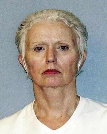 FILE - This undated file photo provided by the U.S. Marshals Service shows Catherine Greig, longtime girlfriend of Whitey Bulger, captured with Bulger in Santa Monica, Calif., in 2011. Greig is serving an eight-year prison term for helping Bulger avoid capture, and faces additional prison time after pleading guilty to contempt in February 2016 for refusing to testify before a grand jury investigating who else may have helped Bulger. (U.S. Marshals Service via AP, File)