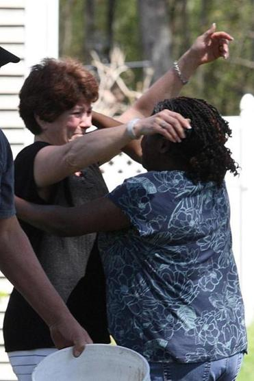 Rosemary Heath (left) greeted a neighbor outside her home Wednesday