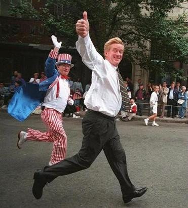 "Weld, shadowed by ""Uncle Sam,"" sprints up Hanover Street in the North End during 1995's Colombus Day parade."