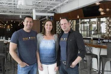 From left: Owners Matthew, Stephanie, and Peter Henry.