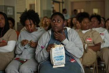 "Adrienne C. Moore (left) and Danielle Brooks in ""Orange Is the New Black."""