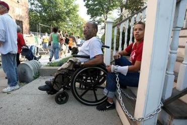 James Brooks was at another protest at that same location in September 2008. Soledad Lawrence chained herself to the stoop.
