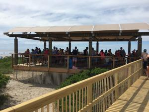 A crowd gathered at The Beach Bar.