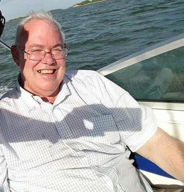 info from Beth Healy: A photo of Scott Wolas, aka Eugene Grathwohl, provided to the police by one of his alleged victims. He is pictured here on a boat, earlier this year. ( NO CREDIT ) DO NOT Redistribute