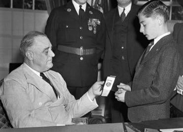 FILE - In this Oct. 15, 1940 file photo, Boy Scout Donn Fendler, of Rye, N.Y., is honored by President Franklin Roosevelt with a gold medal for valor at the White House in Washington. Fendler, who at age 12 survived nine days alone on Maine�s tallest mountain in 1939 and later collaborated on a book about the ordeal, died Monday, Oct 10, 2016, in Bangor, Maine. He was 90. (AP Photo, File)