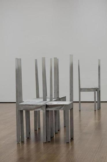 "Chair-themed works in the exhibit ""Doris Salcedo: The Materiality of Mourning."""