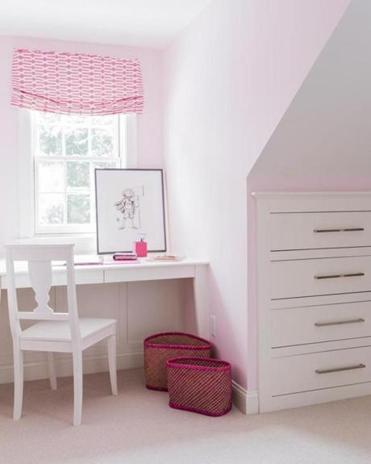A small niche under a dormer was turned into a study space by designer Jill Litner Kaplan.