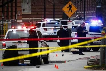 Crime scene investigators collect evidence from the pavement as police respond to an attack on campus at Ohio State University, Monday, Nov. 28, 2016, in Columbus, Ohio. (AP Photo/John Minchillo)