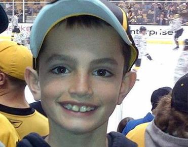 FILE - This undated file photo provided by Bill Richard shows his son, Martin Richard, in Boston. Martin was 8 years old when he was killed by the second of two bombs that exploded near the Boston Marathon finish line in April 2013. On Monday, Sept. 14, 2015, organizers announced the formation of the Martin Richard Bridge Builder Campaign, to encourage children ages 5 through 18 to spread peace through service projects and acts of kindness. (AP Photo/Bill Richard, File)
