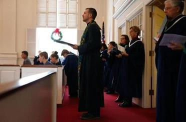 Framingham, MA -- 12/18/2016 - Senior Pastor Gregory R. Morisse (C) leads services at The Plymouth Church in Framingham. (Jessica Rinaldi/Globe Staff) Topic: 25framingham Reporter: