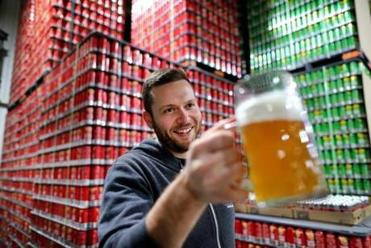 Adam Romanow, founder of Norwood's Castle Island Brewing, has seen his company's business explode this year.