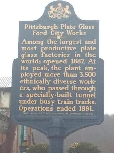 A sign outside the old pedestrian tunnel entrance to the long-shuttered Pittsburgh Plate Glass works.