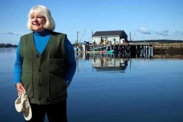 Linda Bean owns this wharf in Port Clyde, Maine, and others in September 2009. Her plan to mass-market lobsters has opponents. Money has been no object for Bean, an heiress to the L.L. Bean fortune, in the two-plus years since she plunged into the struggling Maine lobster industry. To ensure a supply for her lobster roll chain and a supermarket line of lobster products, Bean has spent millions to acquire and upgrade three wharves and buying stations -- where several dozen lobstermen sell their catch -- as well as a processing plant on the state's midcoast. (Craig Dilger/The New York Times)