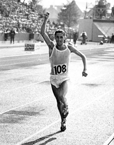 Ron Hill of England crosses the line to win the Marathon, at Meadowbank Stadium, during the British Commonwealth Games in Edinburgh, Scotland, 23rd July 1970. (Photo by Fox Photos/Hulton Archive/Getty Images)