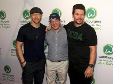 FILE - In this June 23, 2015, file photo, Donnie Wahlberg, from left, Paul Wahlberg and Mark Wahlberg attend the Wahlburgers Coney Island preview party in New York. Five former employees at the Coney Island location filed a federal class action lawsuit against Wahlburgers and the owners of the franchise on Aug. 18, 2016, alleging �rampant� violations of labor laws. (Photo by )
