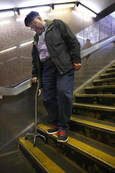 Quincy, MA--2/23/2017 - Carlton Zeigler (cq), of Quincy, uses a four-pronged cane to slowly navigate the stairs from the platform. Using this station for 5 or 6 years, he said an elevator would be welcome. The Wollaston MBTA station, along with the other three in Quincy, is set for a revamp. Photo by Pat Greenhouse/Globe Staff Topic: sombta Reporter: Jill Terreri Ramos
