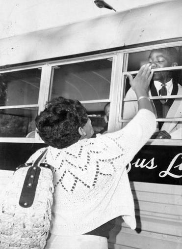 Boston, MA - 9/7/1966: Joan McLarin, of Hutchings Street, says a last minute goodbye to her eighth grade son, Milton, 13, as his bus leaves from Seaver and Harold Streets for Braintree Jr. High School on Sept. 7, 1966, the first day of the voluntary busing program sponsored by Metco (Metropolitan Council for Educational Opportunity), an independent organization funded by the state that transports minority children from racially imbalanced schools in Boston to suburban schools. (Dan Sheehan/Globe Staff) --- BGPA Reference: 140617_MJ_032