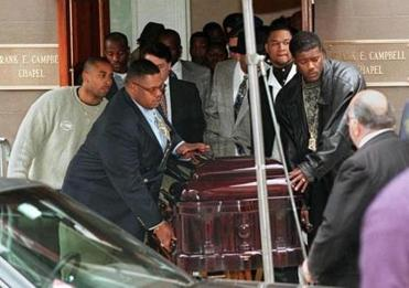 (FILES) This file photo taken on March 18, 1997, shows pallbearers wheeling the casket of rap star Biggie Smalls to hearse after a memorial in New York. Smalls, whose real name was Christopher Wallace, was killed 9 March in a drive-by shooting in Los Angeles. The rap world paid tribute on March 9, 2017, to The Notorious B.I.G., 20 years after he died in a still murky shooting. Diddy, a fellow New York rapper who was one of the slain rapper's proteges, marked the anniversary with an Instagram call for fans to recite their favorite Notorious B.I.G. / AFP PHOTO / STAN HONDASTAN HONDA/AFP/Getty Images