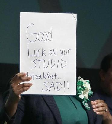 Boston, MA--3/19/2017 - In her opening, Senator Linda Dorcena Forry (cq) holds up what she said was a message from Donald Trump (cq). The St. Patrick's Day Breakfast (cq) is hosted by Dorcena Forry. Photo by Pat Greenhouse/Globe Staff Topic: 20breakfast Reporter: Laura Krantz