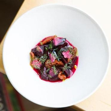 Beets center this first course with dried cherry tomatoes, dill, and salted beach rose at birch, one of Benjamin Sukle's standout restaurants in Providence.