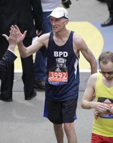 Boston Police Commissioner William Evans was congratulated after finishing the 121st Boston Marathon.
