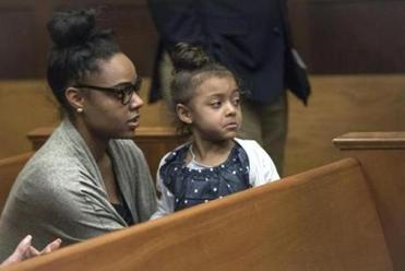 Shayanna Jenkins Hernandez, fiancee of former New England Patriots tight end Aaron Hernandez, sits in the courtroom with the couple's daughter during jury deliberations in Hernandez's double-murder trial at Suffolk Superior Court in Boston, Wednesday, April 12, 2017. Hernandez is charged in the July 2012 killings of Daniel de Abreu and Safiro Furtado, who he encountered in a Boston nightclub. The former NFL football player already is serving a life sentence in the 2013 killing of semi-professional football player Odin Lloyd. (Keith Bedford /The Boston Globe via AP, Pool)