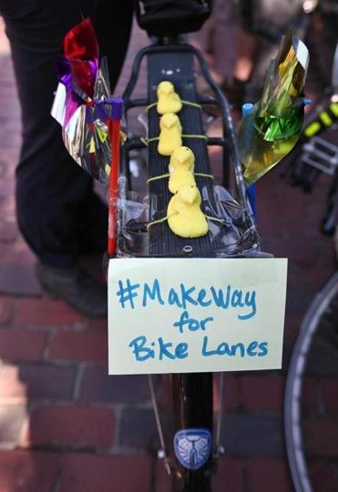Some cyclists at Sunday's Make Way for Bike Lanes rally on the streets around the Public Garden enlisted social media in their campaign.