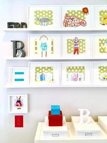Designer Elizabeth Bear used whimsical contact paper as background for her framed artworks.