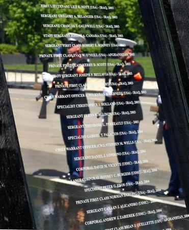 The names of those who died are etched in glass on panels at the Massachusetts Fallen Heroes Memorial.