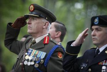 Boston, MA - 5/29/2017 - Brigadier General Peter O'Halloran salutes during a Memorial Day parade in Boston, MA, May 29, 2017.(Keith Bedford/Globe Staff)