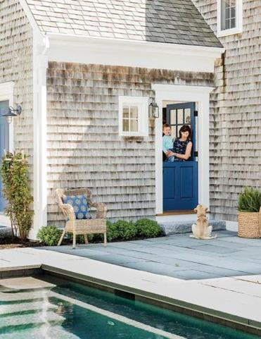 Homeowner Susan O'Bell and her son Dash peek out an entrance overlooking the pool. The Dutch door was installed during the renovation of the house.