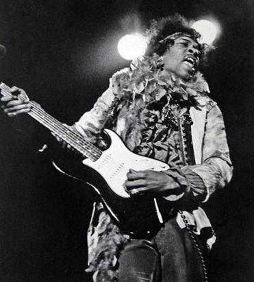 Jimi Hendrix performing at the Monterey Pop Festival.