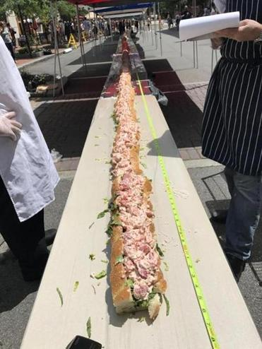 Measuring 159-feet and 6-inches, the mammoth lobster roll was displayed in Portsmouth, N.H.