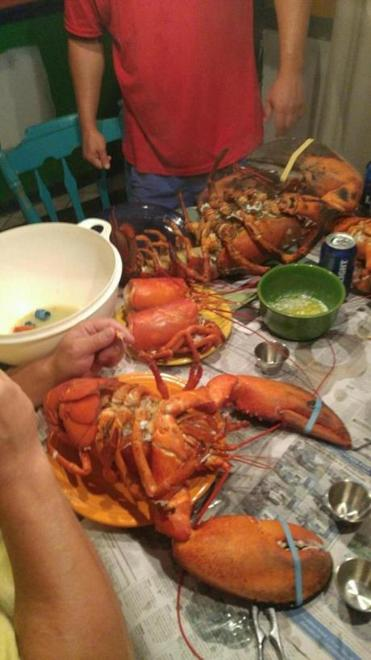 After photos of 15-pound lobster went viral, Christopher Stracuzza served it up for a feast with friends.