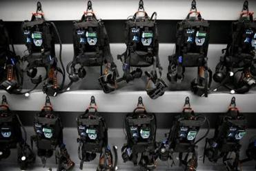 A row of the backpacks worn by virtual players during games.