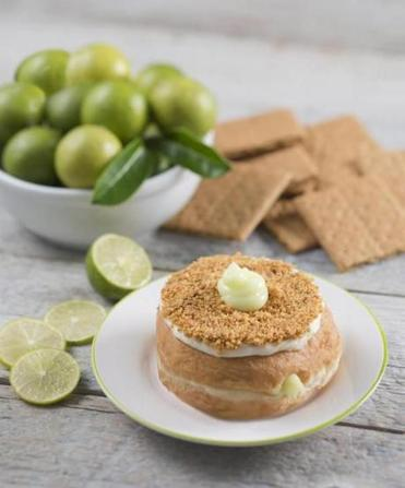 "13nocalendar - A ""hole"" lot of new summertime flavors like this Key Lime Pie donut will grace Kane's Handcrafted Donuts store in Saugus (also Boston) through August 31st. (Tony Scarpetta)"