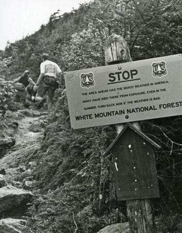 A photo of the sign on Mt. Washington that warns hikers that the area ahead has the worst weather in America and that many have died there even in summer.