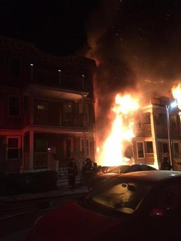 April 23, 2017 fire at #8 Marie Street in Dorchester, a vacant triple decker neighbors repeatedly complained about to city regulators. The photo was taken by a next-door-neighbor, Carrie Bergman, a resident of #6 Marie Street, as she and her husband fled their building, which was heavily damaged by the fire.
