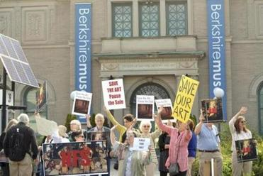 About 40 people opposed to the selling of the Berkshire Museum's art protested in front of the Pittsfield museum on Aug. 12.