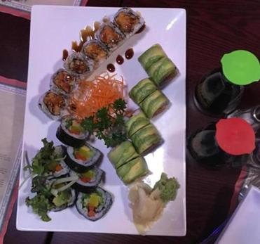 17nodine - ​A platter of Nagoya's caterpillar roll, ​sweet potato roll, and vegetable roll. (Stephanie Schorow)