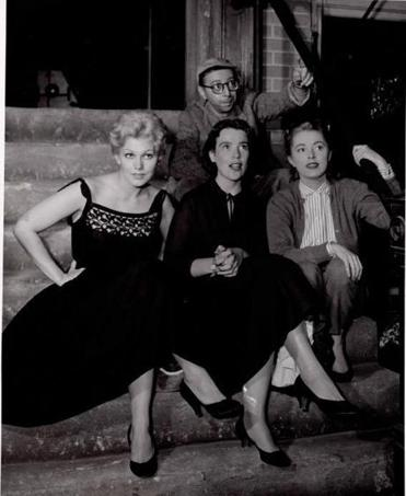 "Mrs. Stang (center) on the set of the 1955 film ""The Man with the Golden Arm"" with her husband, Arnold Stang, and actresses Kim Novak (left) and Eleanor Parker."
