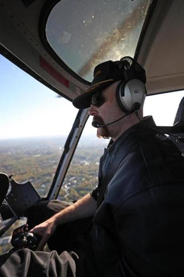 Pilot Jeff Hubbard at the controls aboard a Hover Boston flight.