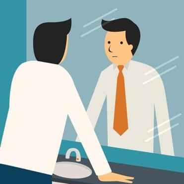 Businessman looking at himself in mirror to encourage and find himself confident.