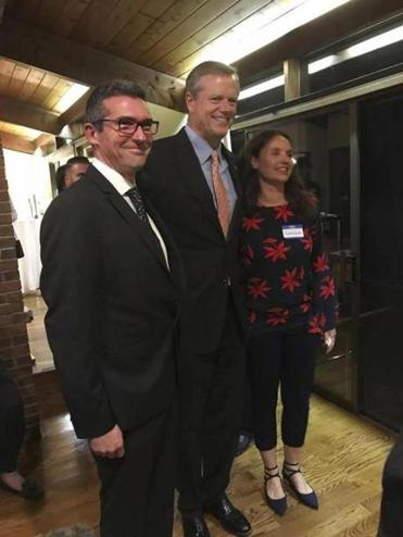 Martin Marro (left) and his wife, Mariana Dagatti (right), posed for a photo with the Massachusetts Governor Charlie Baker in Newton.