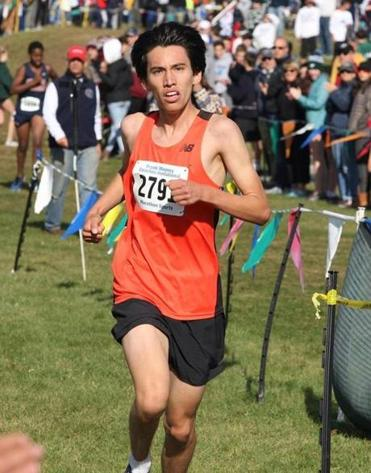 Wrentham, MA 11/05/17.......MTSCA Frank Mooney Coaches Invitational Xcountry.....we key on D1 and D2 junior/senior boys' and girls' races....for SPORTS....(George Rizer for the Globe)......DIV 1 boys winner Andrew Mah.....Newton North... aced the field